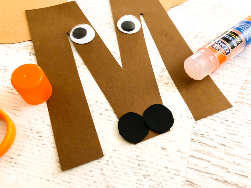 Black circles make the nose on the Letter M is for Moose craft