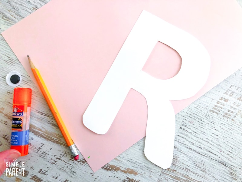 White letter R cut out of card stock