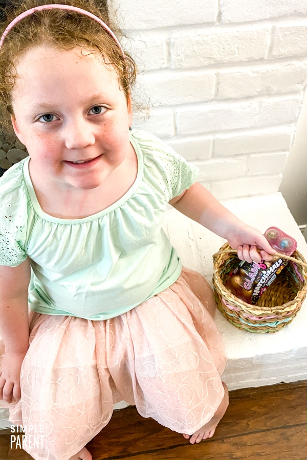 Girl with an Easter basket full of Hatchimals CollEGGtibles Limmy Edish Glamfetti carton