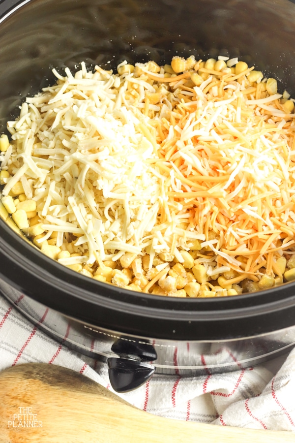 Canned corn and shredded cheese in a slow cooker