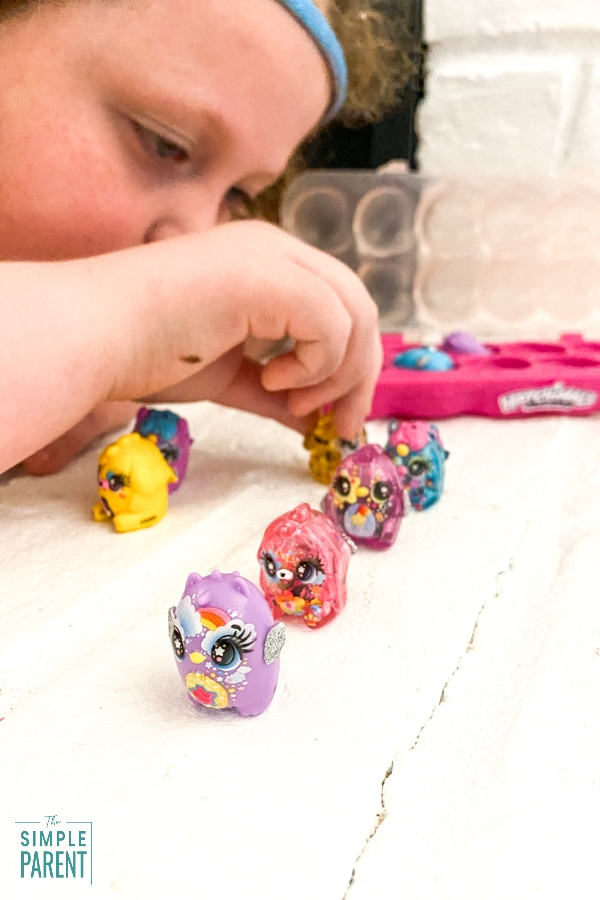 Girl playing with Hatchimals CollEGGtibles egg