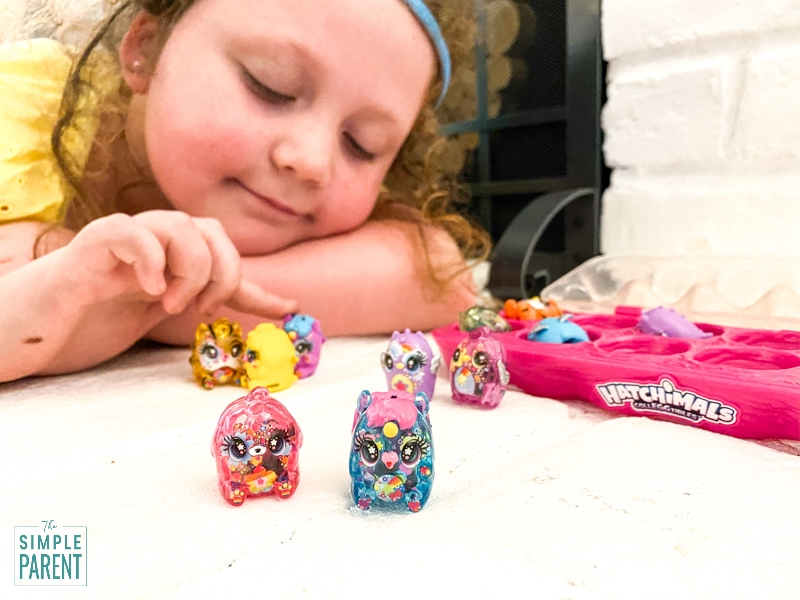 Girl playing with Limmy Edish Hatchimals CollEGGtibles