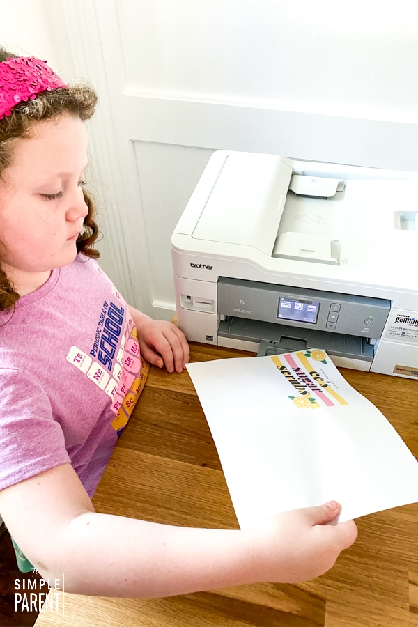 Girl getting paper from printer