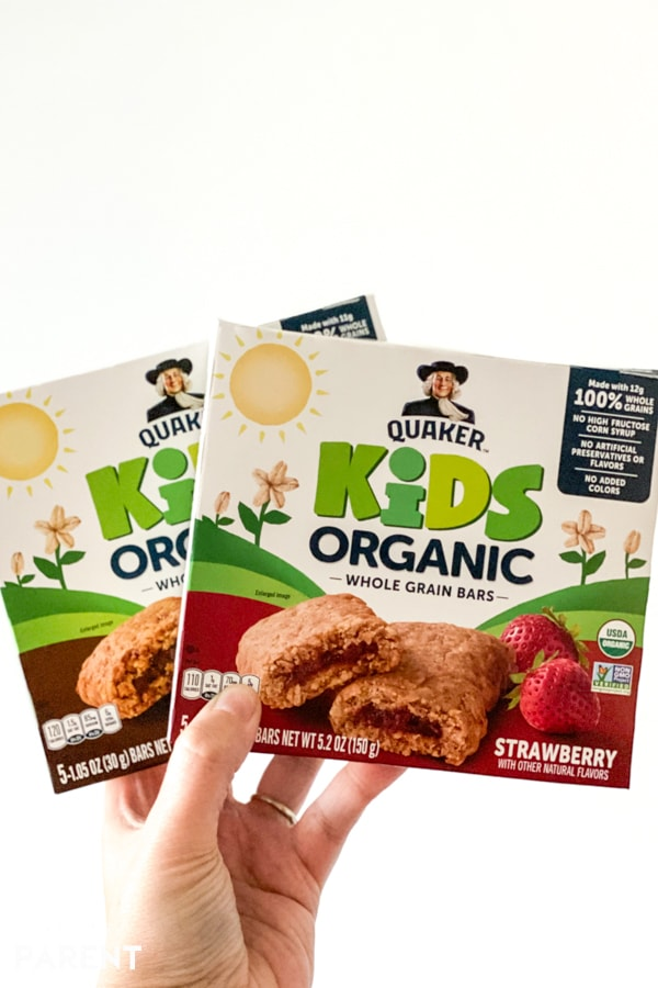 Quaker Kids Organic Bars being held up