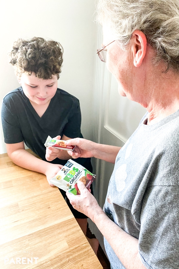 Grandmother and grandson eating Quaker Kids Organic snacks