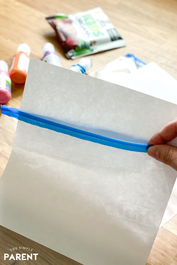 Putting a sheet of paper in a plastic bag