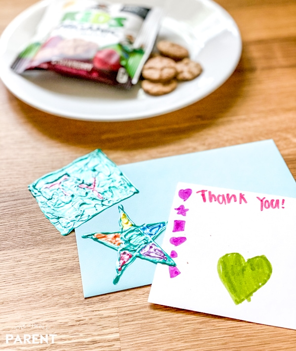 Homemade window clings and thank you card with snacks on a counter