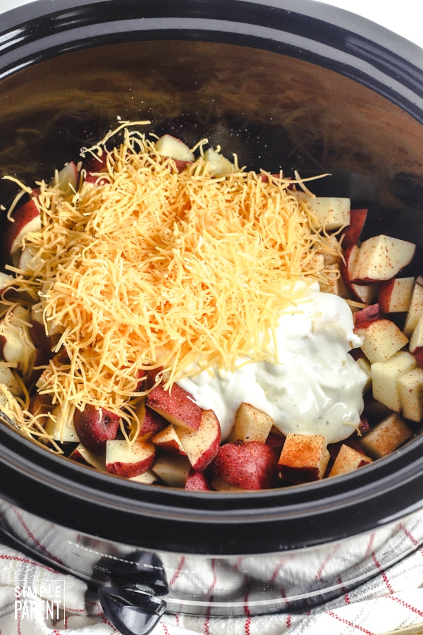 Potatoes, sour cream, and cheese in a Crockpot