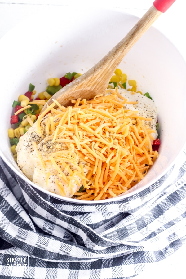 Ingredients for creamy corn salad in a mixing bowl