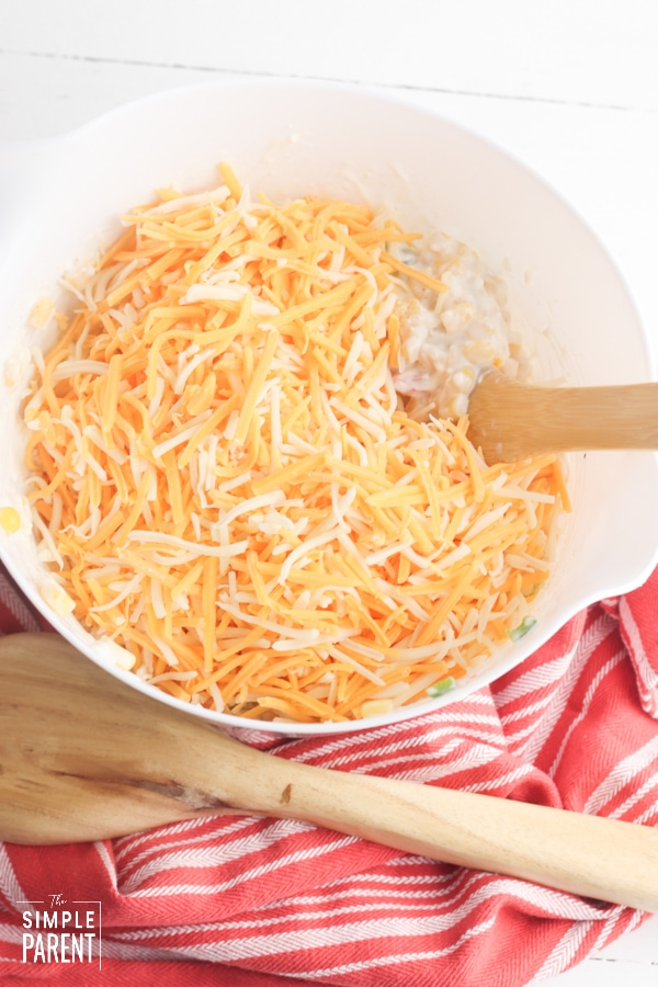 Mixing bowl with shredded cheese in it