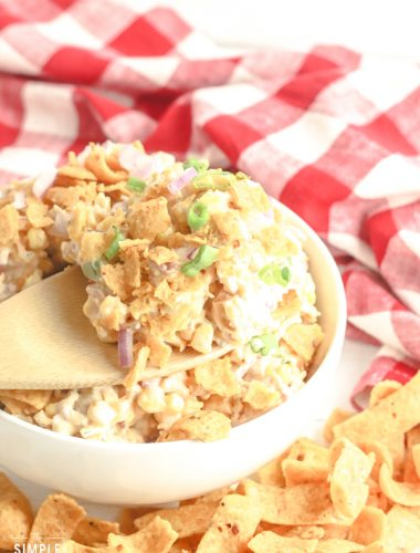 Spoonful of corn chip salad made with Fritos