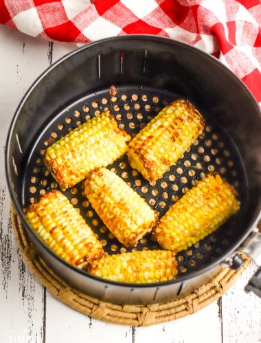 Corn in air fryer basket on counter
