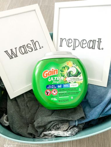 Free printable laundry room signs sitting in laundry basket with Gain Ultra Flings laundry detergent