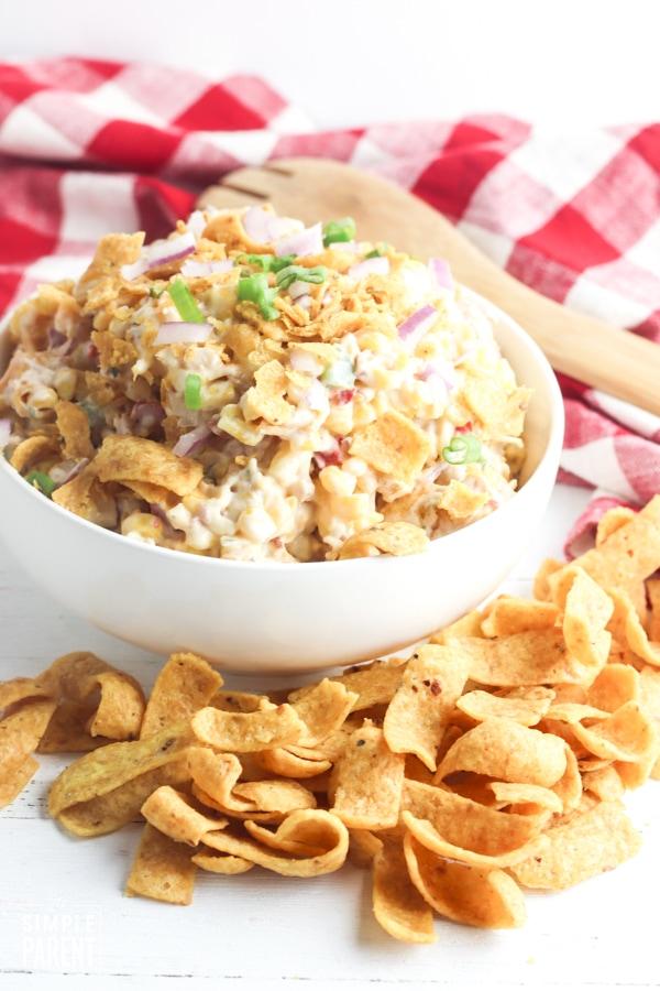 White bowl full of Frito corn chip salad