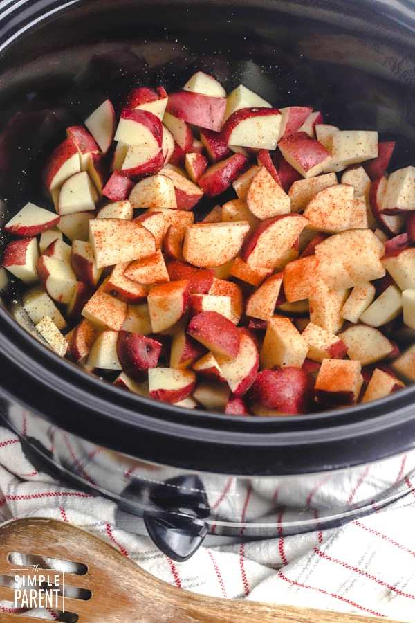 Cut potatoes in crock of slow cooker