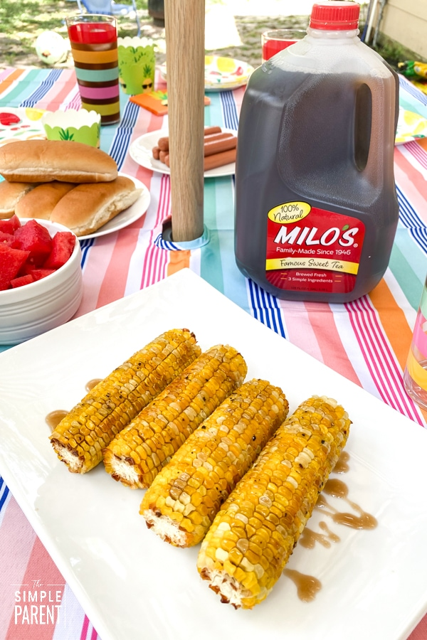 Oven Roasted Corn with Sweet Tea Glaze on a dish with Milo's Sweet Tea