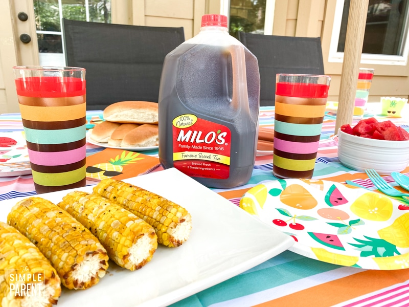 Summer dinner with sweet tea jug and corn on the cob