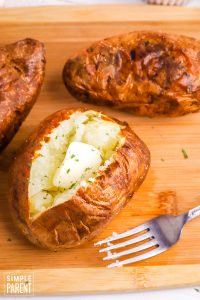 Air Fryer Baked Potato with butter and a fork