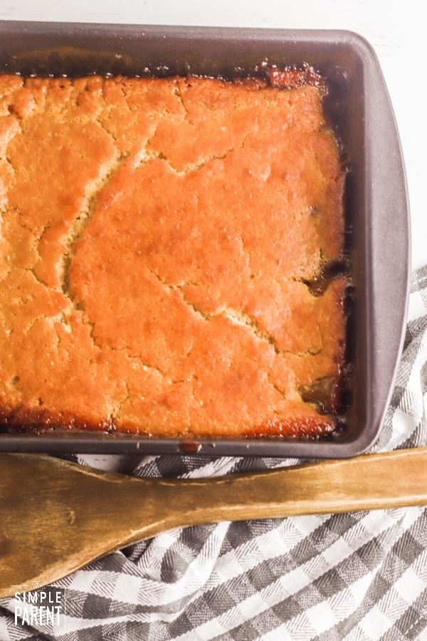 Pan of peach cobbler with pancake mix
