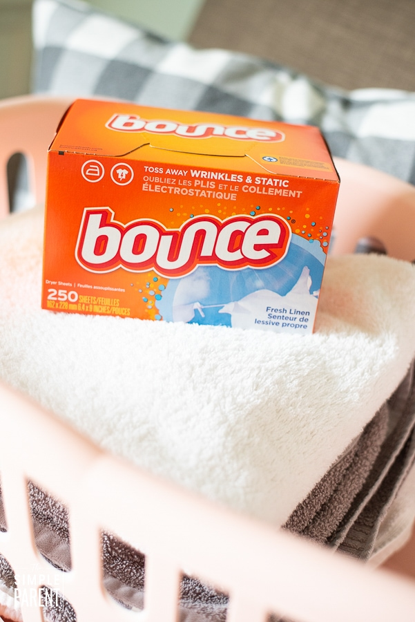 Bounce Fabric Softener in a laundry basket of clean towels