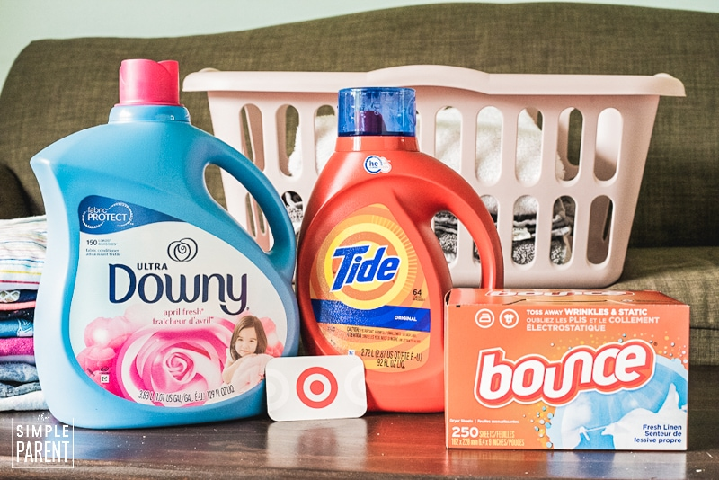 Laundry detergent and fabric softener with laundry basket on a couch
