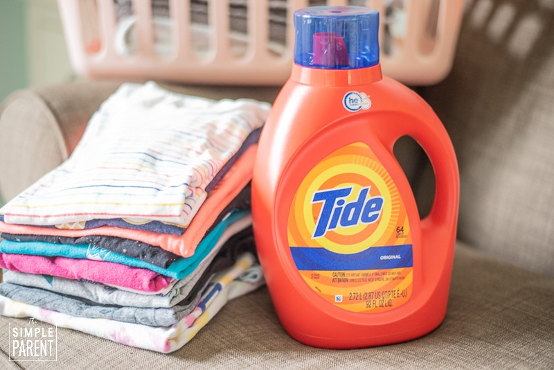 Bottle of Tide Original Laundry detergent and a stack of folded laundry