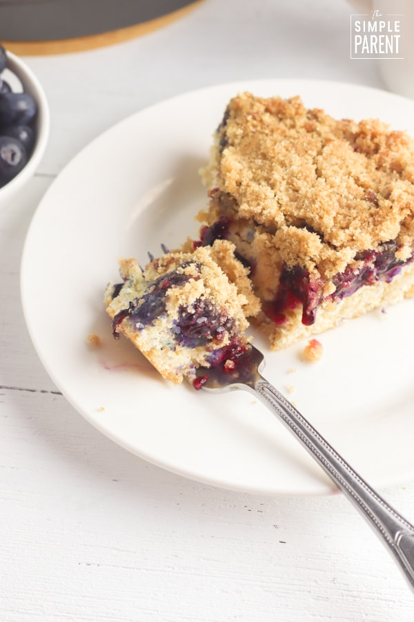 Slice of Bisquick Blueberry Coffee Cake with fork