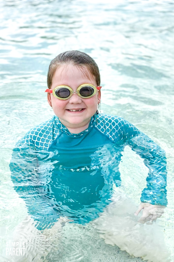 Girl wearing goggles in swimming pool