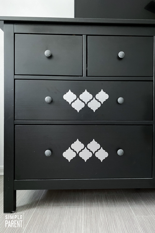 Black dresser with silver vinyl details made with Cricut Joy machine