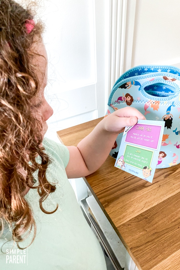 Girl reading lunch box note