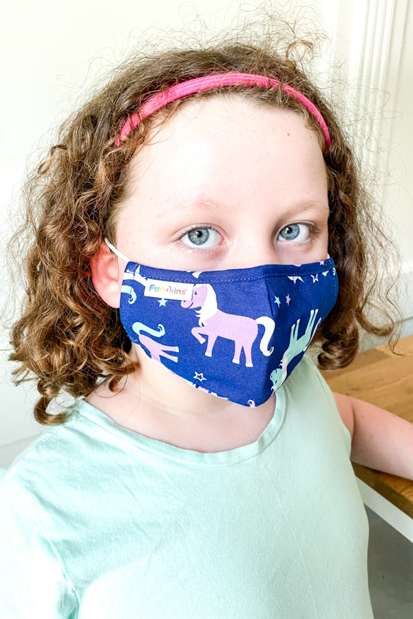 Girl wearing Funkins cloth face mask
