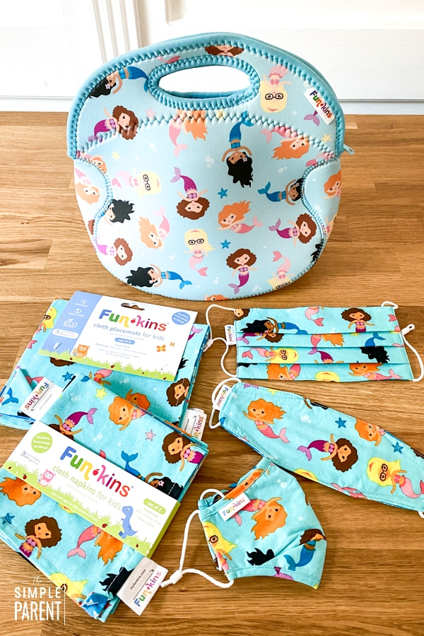 Funkins lunch bag and cloth placemats, napkins, and face masks