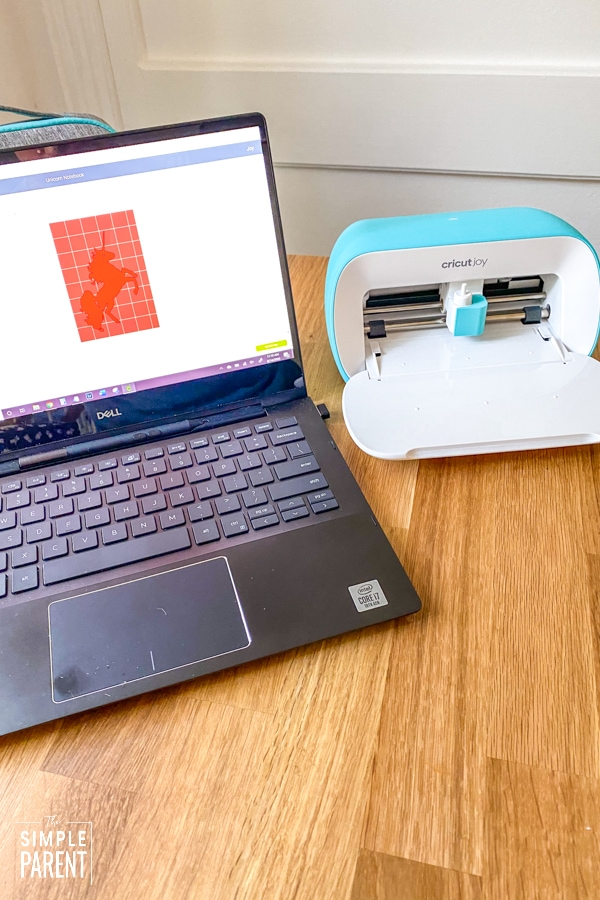 Cricut Joy and laptop with Cricut Access website
