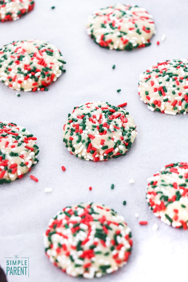 Christmas Sprinkle Cookies on parchment paper