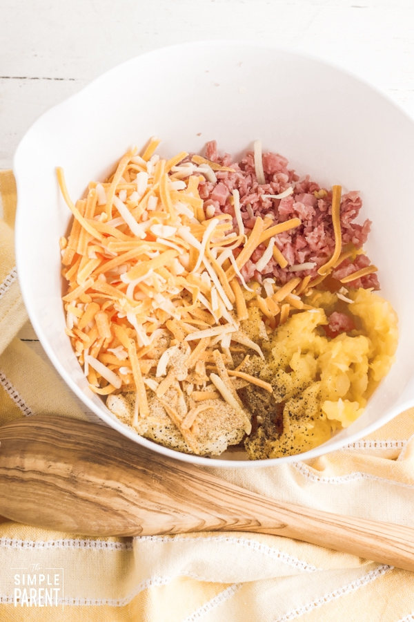 Mixing bowl with ingredients for ham and pineapple dip