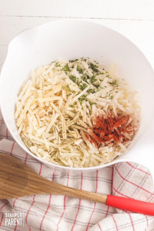 Loaded Hashbrowns ingredients in a white mixing bowl