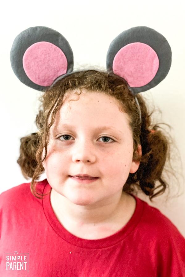 Girl wearing mouse ears