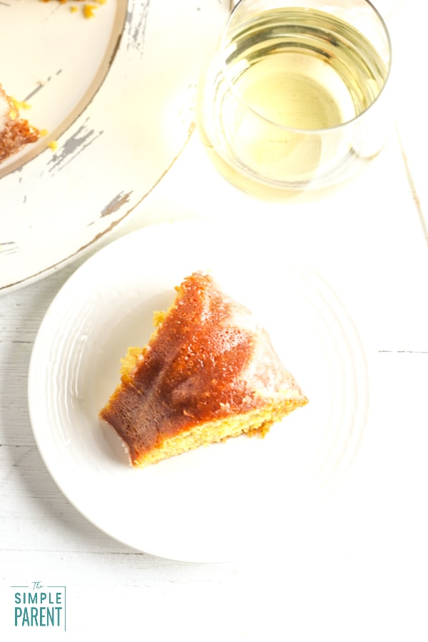 Slice of wine cake on a white plate