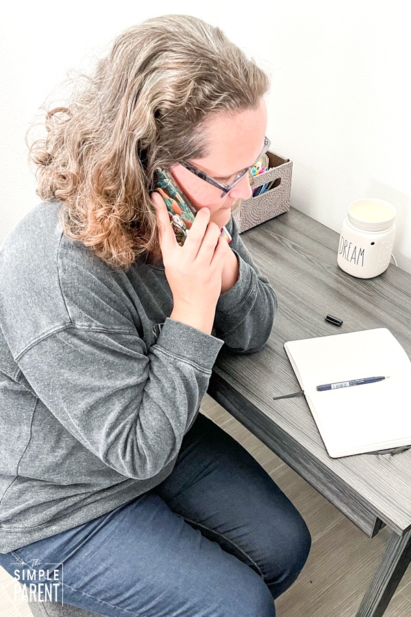 Woman talking on the phone with California Psychics