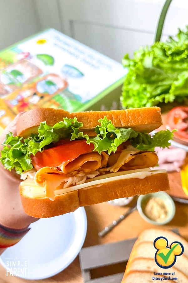 Turkey sandwich with cheese, lettuce, and tomatoes