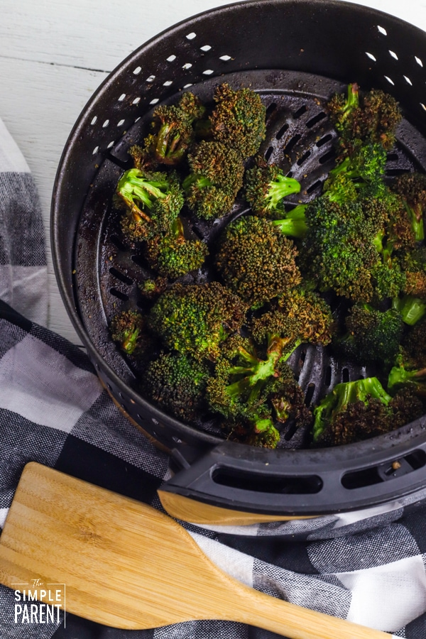 Crispy air fried broccoli in air fryer basket