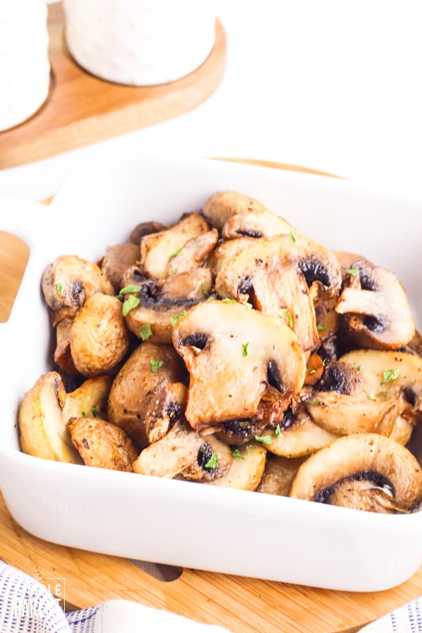 Bowl of air fried mushrooms on cutting board