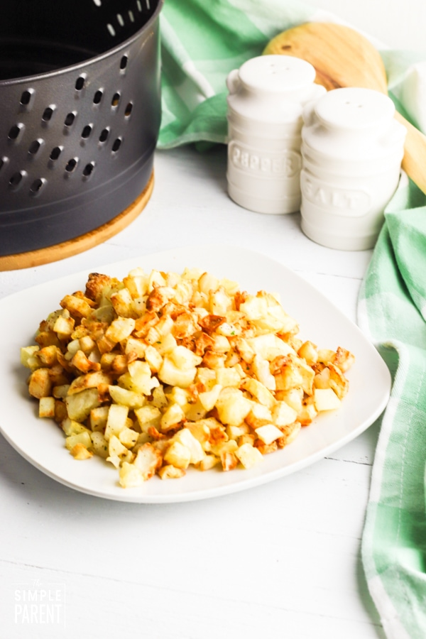Plate of home fries with salt and pepper shaker