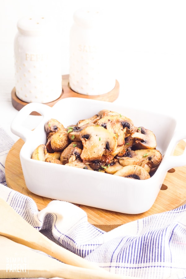Bowl of fried mushrooms with salt and pepper shakers