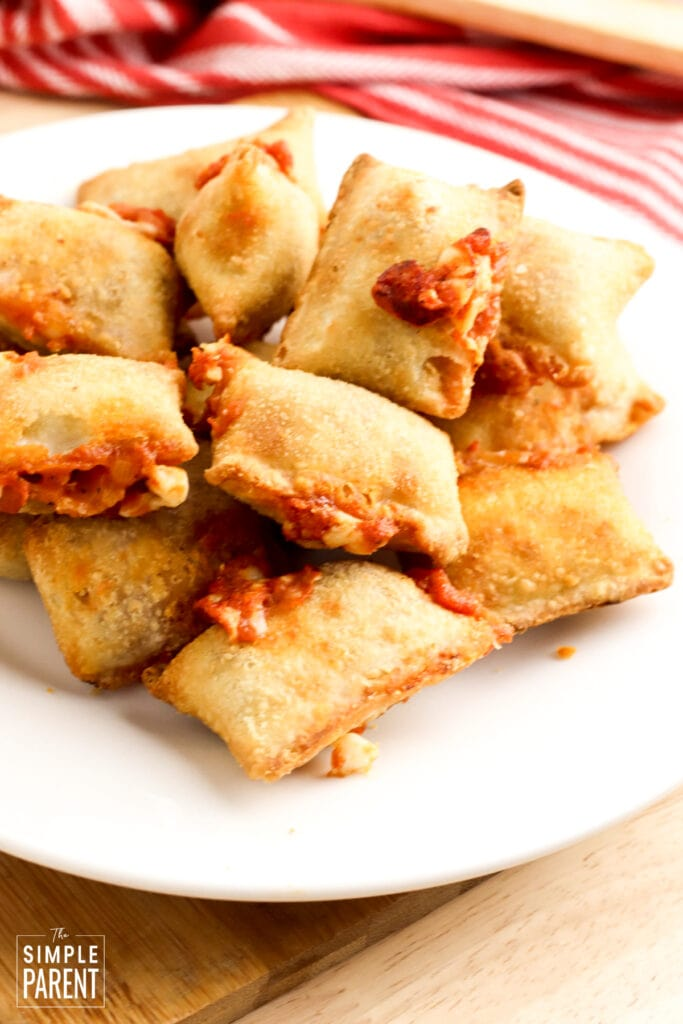 Cheese pizza rolls on a white plate
