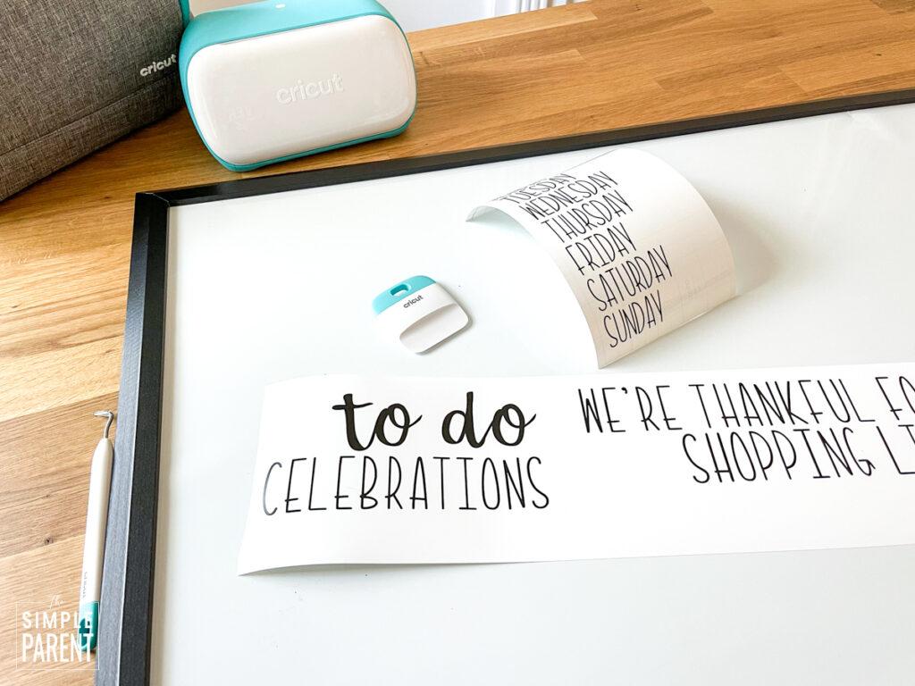 Cricut and materials to make a dry erase board calendar