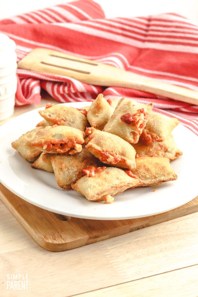 White plate with pizza rolls