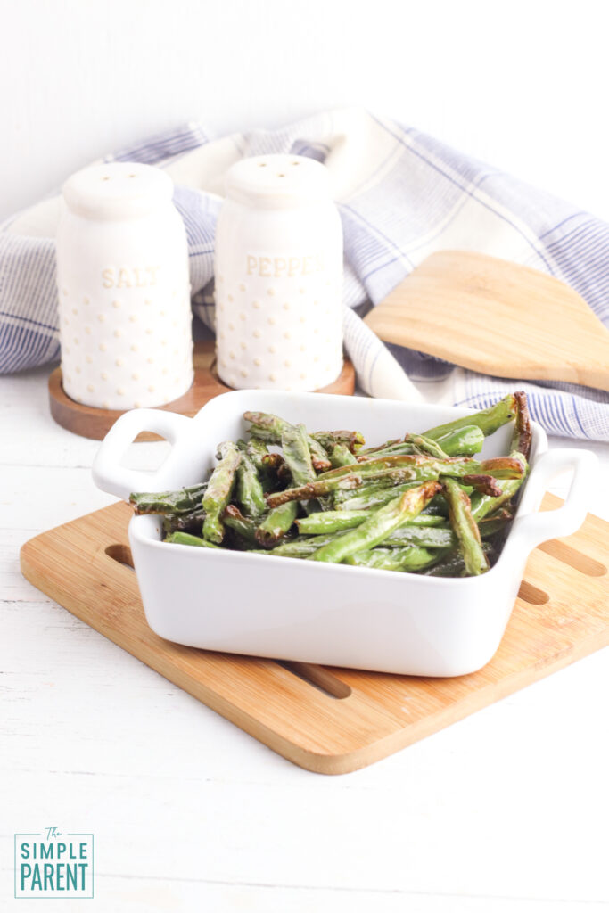 Air fryer green beans with salt and pepper shakers