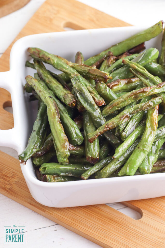 Air Fryer Green Beans in square white bowl