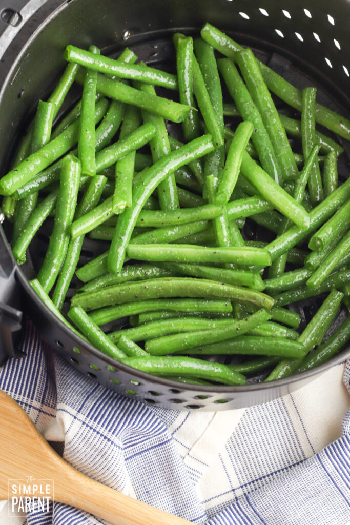 Green beans in air fryer basket